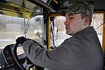 Dirt Boy family pushes snow aside 131209-F-EW167-002.jpg