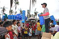 Distributing buckets and jerrycans in Santo Nino, Leyte (11252683455).jpg