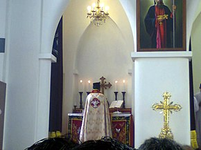 A priest at the altar, with his back to the congregation