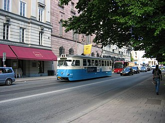 Hamngatan - A heritage tram (streetcar) on the Djurgården line passing in front of the Hallwyl Palace on Hamngatan 4.