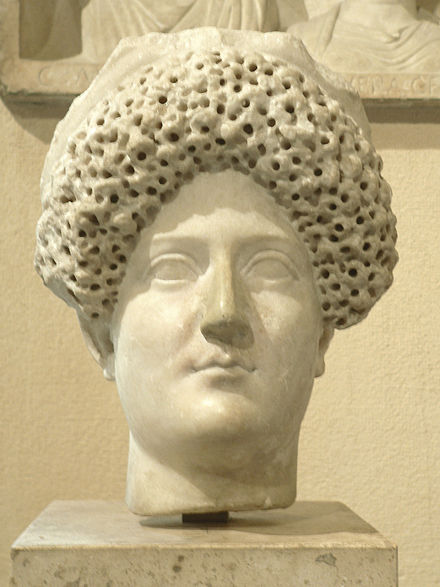 A bust of Domitia Longina, with Flavian hairstyle, (Louvre). Domitia.JPG