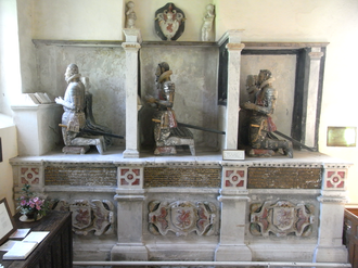 Bernard Drake - Monument to the Drake family of Ash, south aisle of Musbury Church. It depicts the following persons: left: John VI Drake (d.1558), with his wife Amy Grenville (d.1577); centre: Admiral Sir Bernard Drake (c.1537–1586), his son, with his wife Gertrude Fortescue (d.1601); right: John VII Drake (d.1628), who erected the monument in 1611, son of Sir Bernard, with his wife Dorothy Button (d.1631). Also shown four times are the arms of Drake: Argent, a wyvern wings displayed and tail nowed gules. Gilded inscribed biographical tablets appear under each couple of kneeling figures