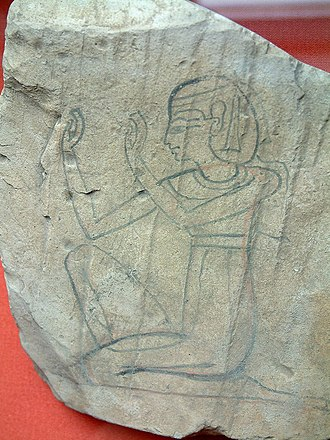 Man-seated: arms in adoration (hieroglyph) - Limestone figured ostracon of a seated individual, presumably a woman..