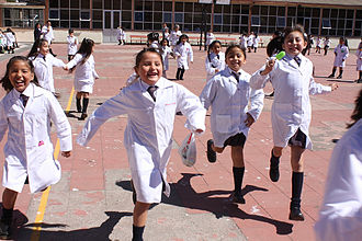 Women in Chile - School girls running in the school yard