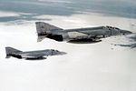 F-4S Phantom IIs of VF-103 in flight over Nevada in 1982.jpg