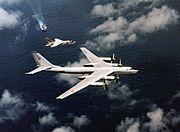 F-8J Crusader of VF-194 escorting a Soviet Tu-95 over USS Oriskany (CVA-34) on 25 May 1974