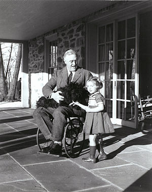 Margaret Suckley - One of Suckley's photographs of FDR in his wheelchair, with Ruthie Bie and Fala (February 1941)