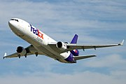 FedEx McDonnell Douglas MD-11 during a test flight of the Guardian, which can be seen mounted to the belly aft of the wings.