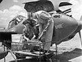 First Lieutenant H. A. Blood examines ammunition.jpg