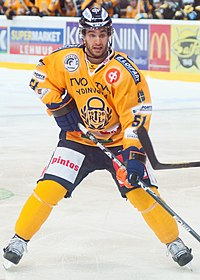Frans Nielsen skating with his hockey stick as a Rauman Lukko team member.