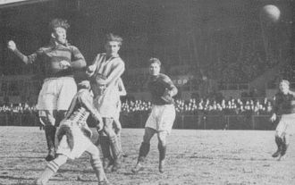 Boldklubben Frem - Match against AB around 1940. Frem players (hooped shirts): Pauli Jørgensen (far left), Johannes Pløger (2nd from right) and Erling Sørensen (far right).