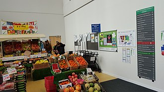 Manchester University NHS Foundation Trust - Fruit and vegetable stall at main entrance of Manchester University NHS Foundation Trust