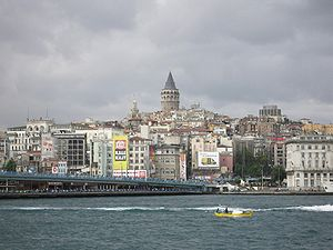 Galata Tower as seen from the entrance of the Golden Horn, with the Galata Bridge seen at left