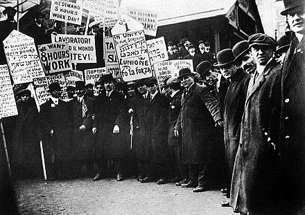 Garment workers on strike in New York City holding multilingual signs, including in Russian, circa 1913 Garment Workers on Strike, New York City circa 1913.jpg