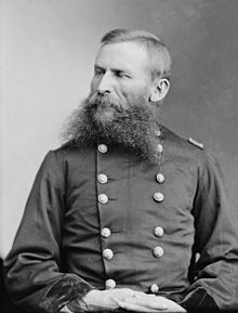 Black-and-white picture of a forked-bearded man in an army uniform