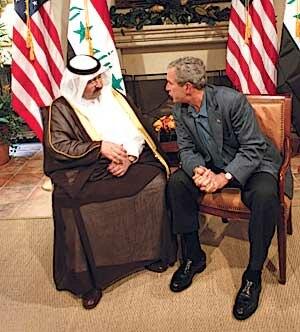 Ghazi Mashal Ajil al-Yawer - President George W. Bush confers with al-Yawer during the 9 June 2004 G8 summit at Sea Island, GA.