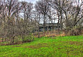 Gfp-wisconsin-ice-age-trail-house-behind-trees.jpg