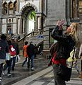 GirlTakingPhoto in Antwerp Central Station.jpg