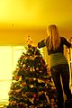Girl Hanging Star on Holiday Christmas Tree - Photo by D. Sharon Pruitt.jpg
