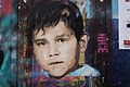 Graffiti in Shoreditch, London - Child portrait by Rice (9447111888).jpg