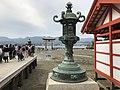 Grand torii and lantern of Itsukushima Shrine.jpg