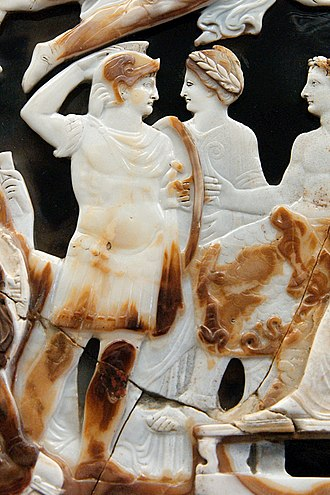 Nero Julius Caesar - Nero (on the left), saluting Tiberius (seated, on the right)(detail of the Great Cameo of France).