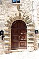 Gubbio, palazzo via XX settembre, portale bugnato.JPG