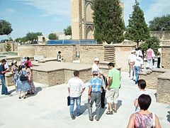 Guri Amir (Samarkand)-12. Outside with visitors.jpg