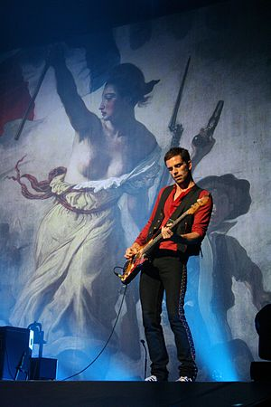 Guy Berryman - Berryman performing during Coldplay's 2008 Viva la Vida Tour.