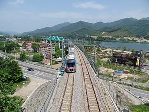 Gyeongchun Line Guuncheon Bridge with Korail EMU Class 361015 Bound for Chuncheon.jpg