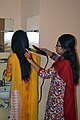 Hair being straightened with a flat iron (01).jpg