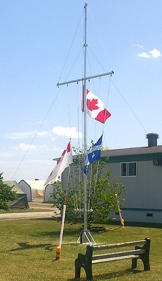 Half-mast - The flag of Canada, the flag of Québec, and the flag of the Royal Canadian Sea Cadets are half masted on board Bagotville Cadet Summer Training Centre, following the train detrailment and explosion of Lac Mégantic, Québec.