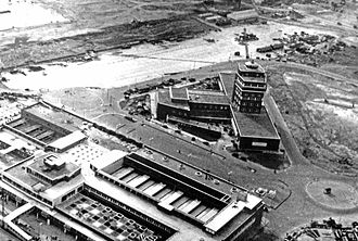 History of Heathrow Airport - Heathrow's central area under construction in April 1955. The control tower is complete and in use. Work proceeds on the Europa Building