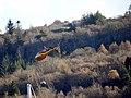 Helicopter filling water bucket in Tobermory Bay (44231269030).jpg