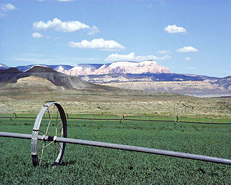 Henrieville, Utah - Rolling irrigation pipes keep fields green in Henrieville.