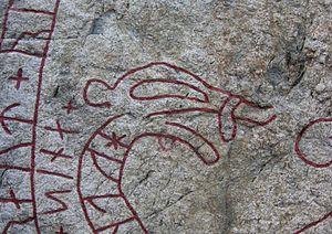 Gamla Turingevägen Inscriptions - Detail showing serpent head on Sö 311.