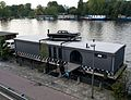 Houseboat with car atop.jpg