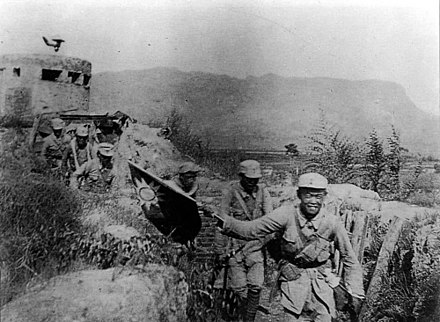 Victorious Chinese Communist soldiers holding the flag of the Republic of China during the Hundred Regiments Offensive Hundred Regiments Offensive 1940.jpg