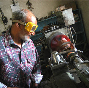 International Assistance Mission - An Afghan IAM RESAP engineer working on a micro-hydro turbine.