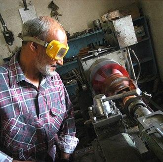 International Assistance Mission - An Afghan IAM RESAP engineer working on a micro-hydro turbine.
