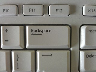 Backspace computer keyboard key used to delete the character preceding the cursor