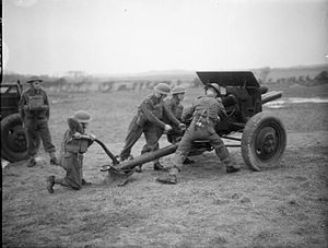 Whitley Bay -  British airmen man a 75mm field gun during training at No. 2 RAF Regiment School, Whitley Bay (then Northumberland), UK.