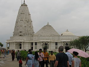 Secularism in India - A Hindu temple in Jaipur, India merging the traditional tiered tower of Hinduism, the pyramid stupa of Buddhism and the dome of Islam. The marble sides are carved with figures of Hindu deities, as well as Christian Saints and Jesus Christ.