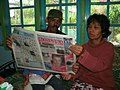 Indonesians with newspaper.jpg