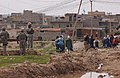 Iraqi police, U.S. Soldiers patrol neighborhood in Mosul DVIDS40282.jpg
