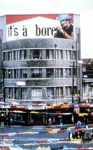 "Détournement - A cigarette advertisement on a billboard turned into a détournement by defacing the cowboy image and modifying the text, probably including ""Marlboro,"" to read ""It's a bore."""
