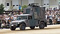 JGSDF High Mobility Vehicle(06-7521) with shelter of JMRC-C6-B left front view at Camp Itami October 8, 2017.jpg