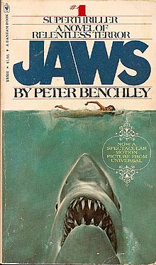 "Painting of a shark head rising up on a naked swimmer. Atop the cover is ""#1 Superthriller - A Novel of Relentless Horror"", followed by the title and author, ""Jaws by Peter Benchley""."