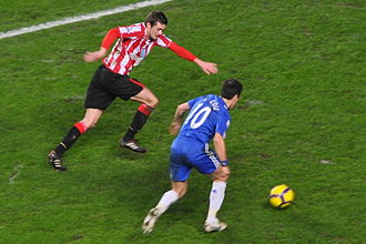Joe Cole - Cole, playing for Chelsea, taking on Sunderland player George McCartney