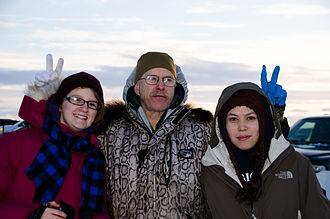 Jeff King (mushing) - Jeff King (center) posing for photos with spectators during the 2013 Kuskokwim 300.